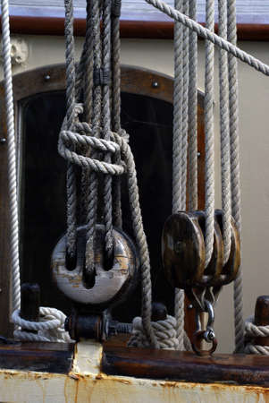 pulleys: Details of a ships rope pulleys. Stock Photo