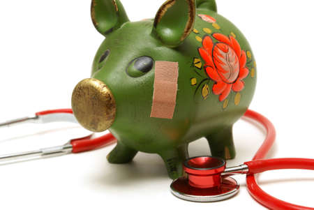 hospital fees: A pig bank wears a bandage to help repair his damaged account.