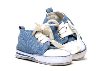 baby shoes: A pair of denim baby shoes for the toddlers feet. Stock Photo
