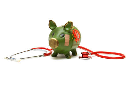 A pig bank wears a bandage to help repair his damaged account. Stock Photo - 21618135