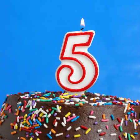 5 years: A number candle is lit in celebration of five years. Stock Photo