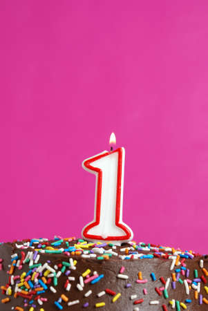 A number candle is lit in celebration of the first year. photo