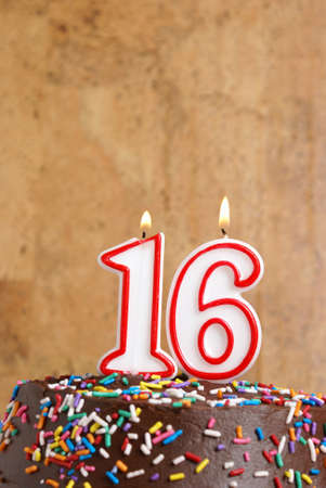 A number candle represents sixteen sweet years worth celebrating. photo