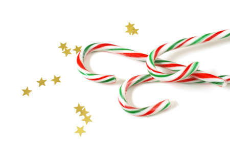 A festive group of delghtful candycanes with star confetti. photo