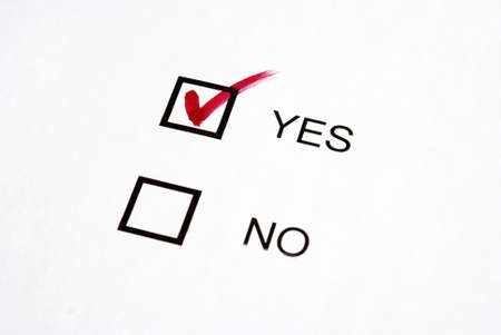 confirmed: A checkmark votes for yes in this survey. Stock Photo