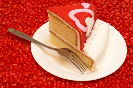 A cake slice for a romantic evening of indulgance. Stock Photo - 25441733