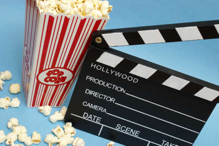 action movie: A clean clapboard and popcorn to express the movie industry.