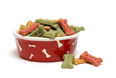 dog biscuit: An isolated shot of a bowl full of dog treats. Stock Photo