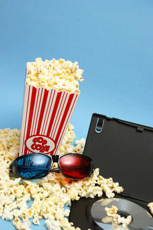 photographic effects: A 3D home movie experience with popcorn and glasses. Stock Photo