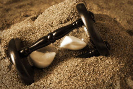An hourglass is lost in the sands of time  Stock Photo