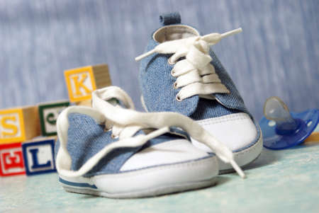 A cute pair of denim baby shoes for the young boy. photo