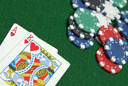 A great poker hand is laid down on the gaming table. 版權商用圖片
