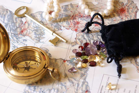 A low contrast still-life of things someone would have during a treasure hunt. Standard-Bild