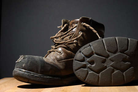 worn: A pair of worn work boots showing their texture.            Stock Photo