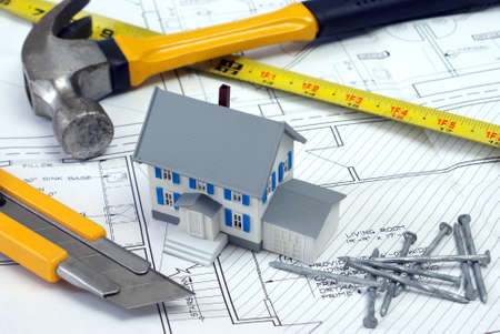 architect tools: An architect has designed blueprints for a new house project. Stock Photo
