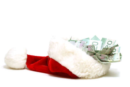 A financial concept for the holidays using a santa hat and some money. Archivio Fotografico