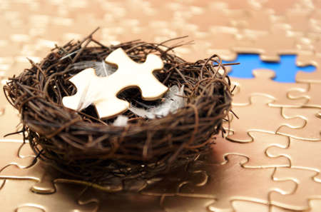 networked: A nest holds the missing piece to a golden connection of other networked pieces.