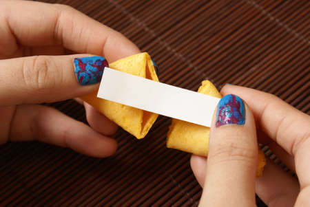 reveal: A woman reveals her hidden message within the fortune cookie which is left blank for your own personal text to be inserted.