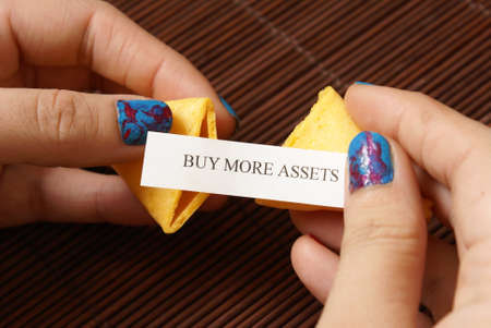 reveals: A woman reveals her hidden message within the fortune cookie.