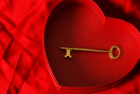 key box: A key is placed inside a heart shaped box for the affection of loyalty. Stock Photo