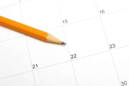 sharpened: A sharpened pencil rests on a calendar for use in planning the days in the month. Stock Photo