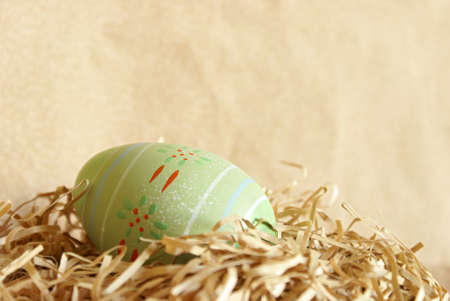 shred: A well decorated Easter Egg hides in the pastel colored paper shred.