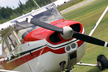 cessna: A small engine plane is parked on the airfield.