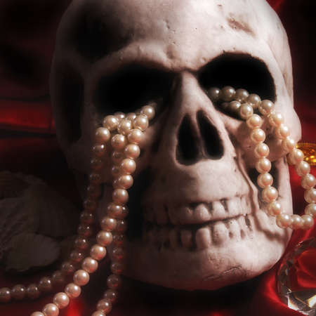 cursed: An old human skull with some expensive treasure nearby. Stock Photo