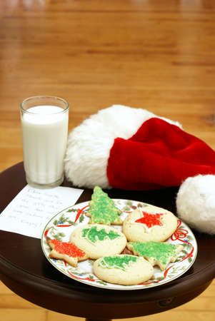 milk and cookies: A plate of homemade sugar-cookies for Santa on Christmas Eve. Stock Photo