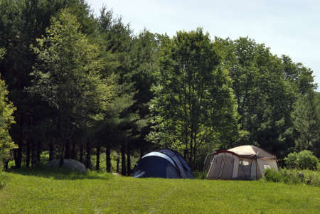 pitched: A couple tents are pitched for some summertime camping. Stock Photo