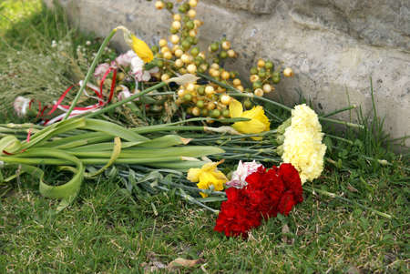 bouqet: A bouqet of fresh flowers lay in respect at the foot of this gravestone.