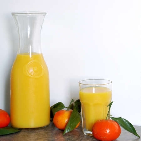 litre: A square format image of a one litre pitcher of refreshing citrus juice blended for a good start to a healthy morning routine. Stock Photo