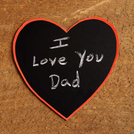 rendition: A childish artwork rendition using chalk and hearts to express the unconditional love for their dad. Stock Photo