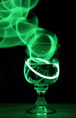 alcoholic drink: A neon glowing party drink illuminated in the nightclub. Stock Photo