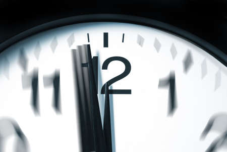second meal: A macro shot of a clock with one minute left to 12. Stock Photo