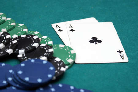 dealt: A pair of aces are dealt within a poker hand. Stock Photo