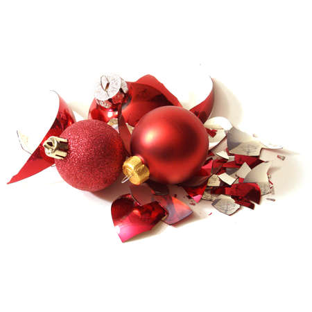 pileup: A smashed red holiday bauble has fallen to many pieces.