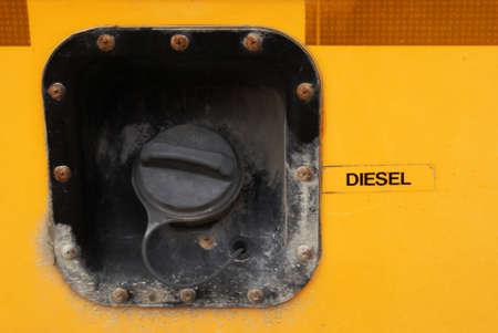 Closeup of a school bus fueling cap.