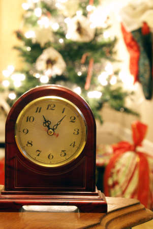 Mantle clock with Christmas tree blurred in background.