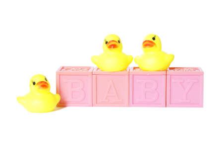 Isolated baby blocks with rubber ducks.
