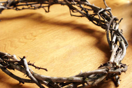 Closeup view of a handmade Crown of Thorns resting on top of a wooden board. Reklamní fotografie