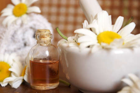 fragrant: Closeup of an herbalist station preparing some fresh chamomile essential oils for bottles. Stock Photo
