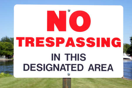 private access: Closeup view of a No Trespassing sign for a specific area. Stock Photo