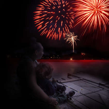 A loving embrace of this closeup view of mother and son enjoying the celebration during the fireworks display.
