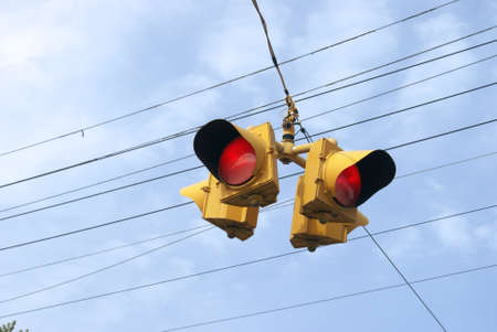 Closeup on a daytime running four way red light for traffic use in Eastern Canada.