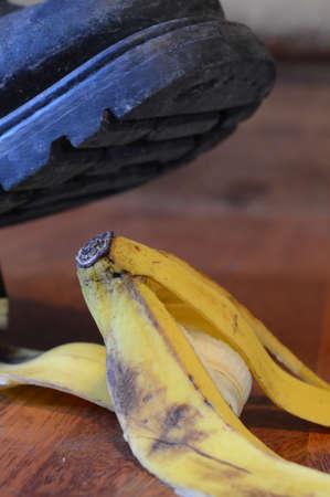 A man is about to step on a banana peel. Фото со стока
