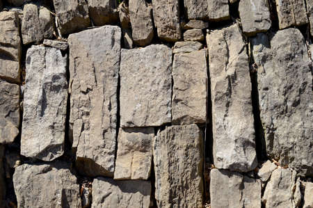 A background texture image using a stone wall made by masons.