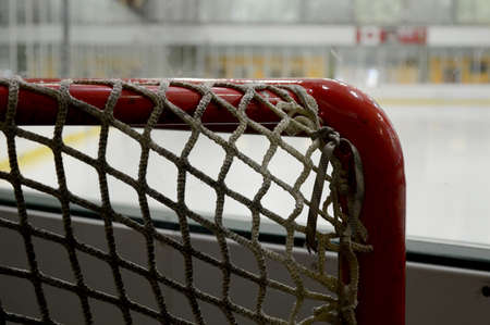 Focus on the hockey net behind the ice surface before the game starts.