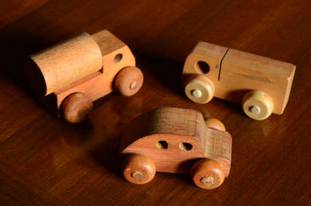 Three wooden vehicles made for early childhood playfullness.