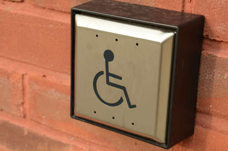 Closeup view of a disability door access button for easy entrance of the public building. 版權商用圖片